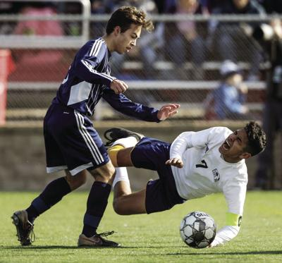 WIAA state boys soccer photo: McFarland's Brett Connor goes down