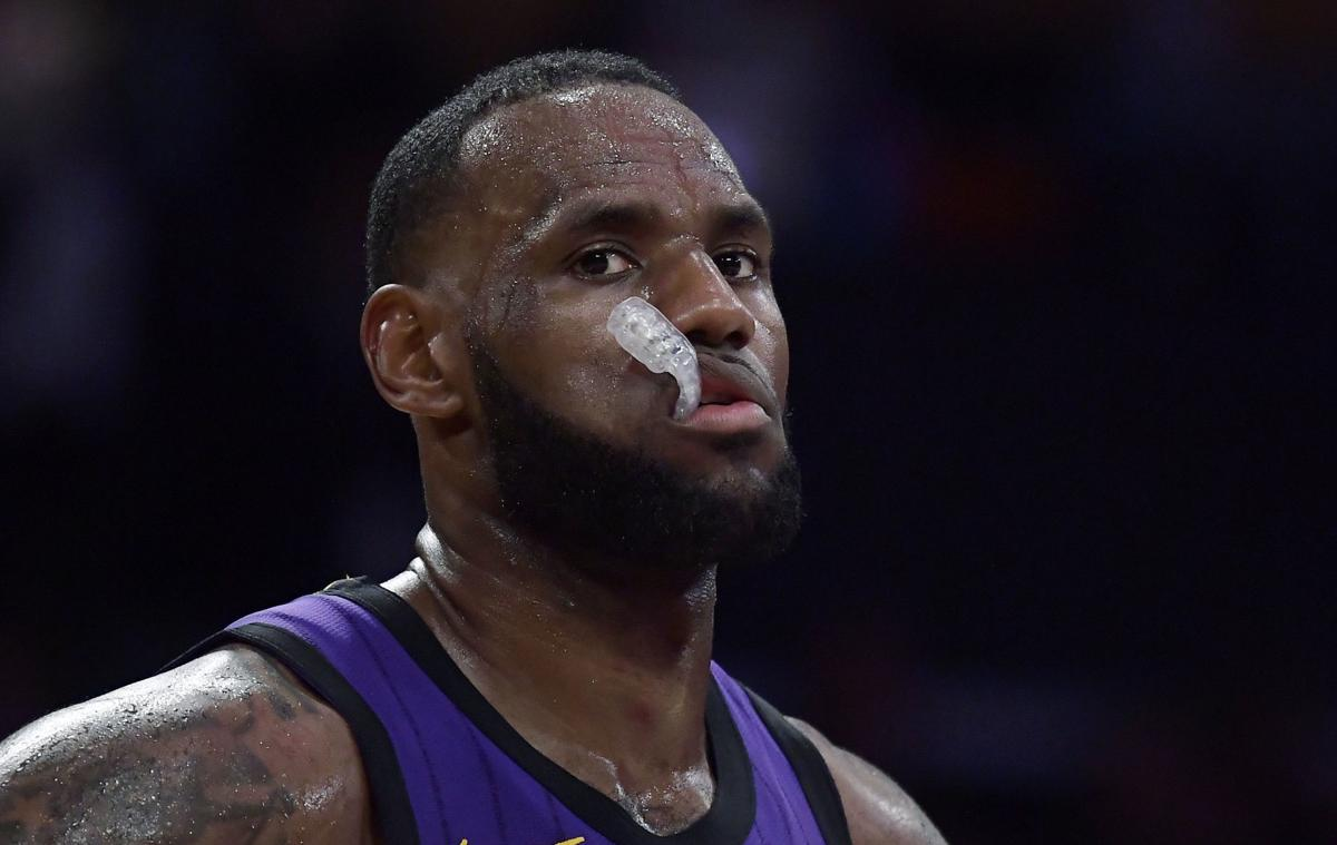 LeBron James mouthguard, AP photo