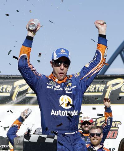 Brad Keselowski celebrates, AP photo