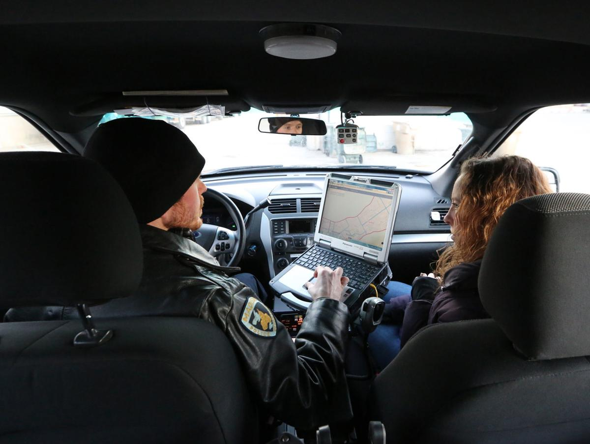 Andrew and Sarah in squad car
