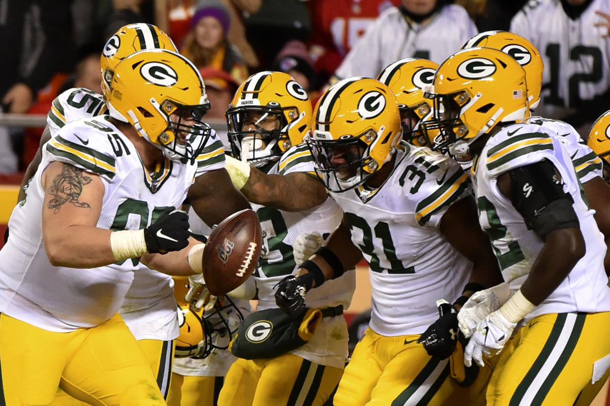 Packers celebrate Tyler Lancaster fumble recovery, AP photo