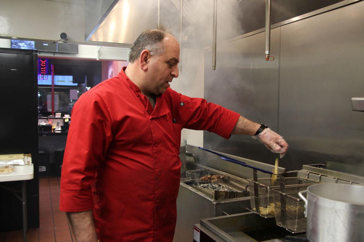 Co-owner and head chef Emin Buzhunashvili preparing a lab kabob plate with fries  .JPG