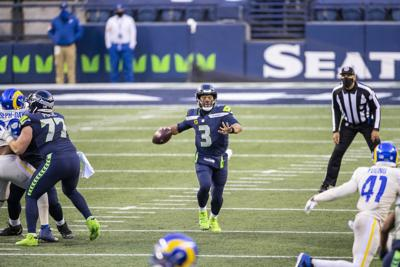 In this file photo, with protection and room to throw, Russell Wilson went 20-32, with 225 yards and a touchdown in a 20-9 win over the Rams.