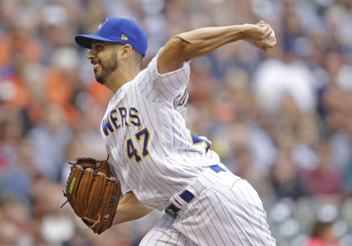 brewers starting pitchers don t mind giving way to stellar bullpen