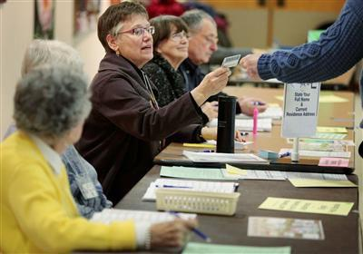 At least 590 provisional ballots cast last week because voters lacked proper ID