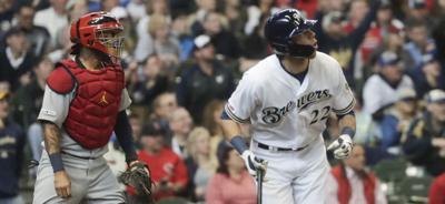 Christian Yelich watches homer, AP photo