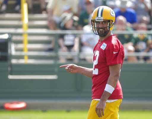 Aaron Rodgers reacts at camp, AP photo