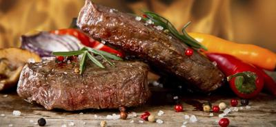 Pair of steaks with peppers (copy)