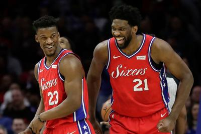 Philadelphia 76ers guard Jimmy Butler (23) and center Joel Embiid (21) share a laugh late in the fourth quarter against the Denver Nuggets on February 8, 2019, at the Wells Fargo Center in Philadelphia.