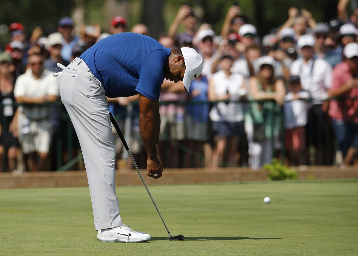 Tiger Woods reacts, AP photo