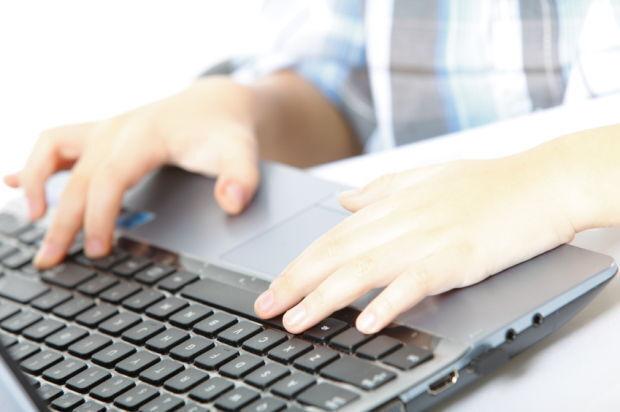 generic stock photo student laptop virtual school (copy)