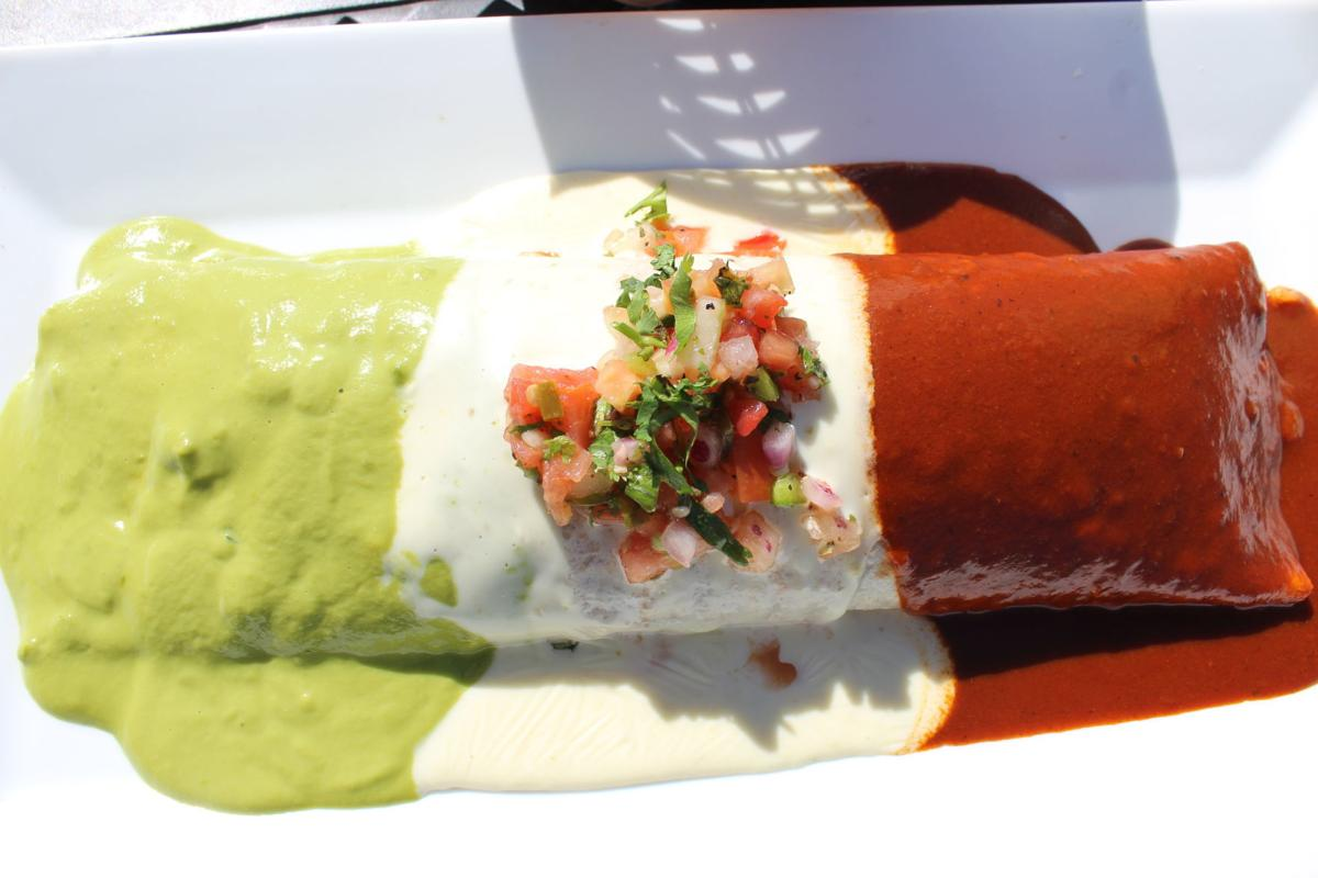 12-inch Burrito Bandera, stuffed with ground beef, beans, rice and cheese and topped with Verde sauce, cheese sauce and red sauce with salsa garnish on top.  .JPG