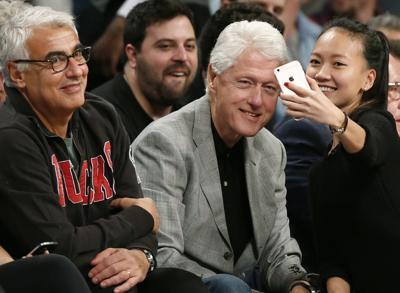 Marc Lasry, Bill Clinton, AP photo
