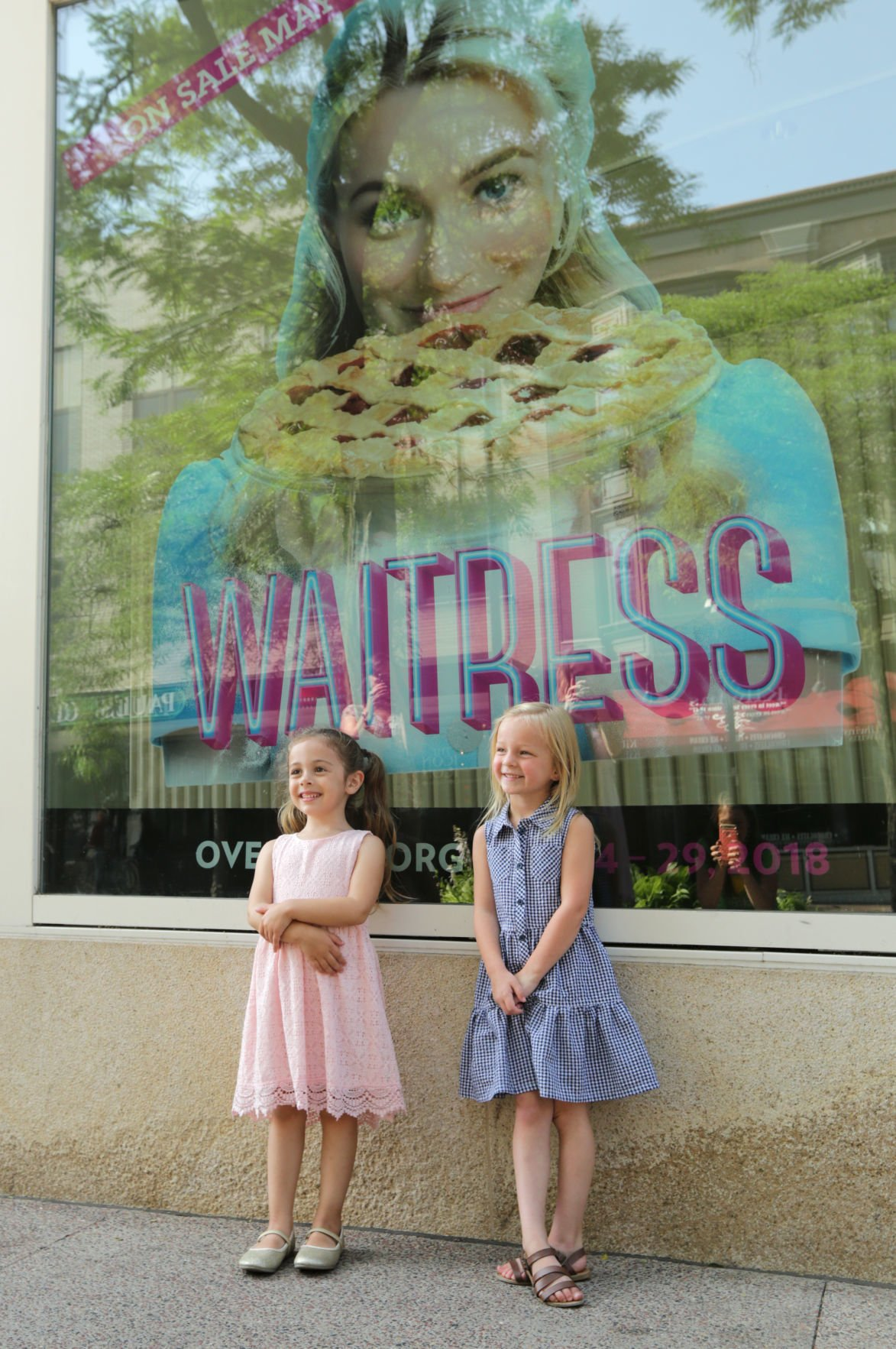 Addie Manthey and Rosie Manson outside Overture window