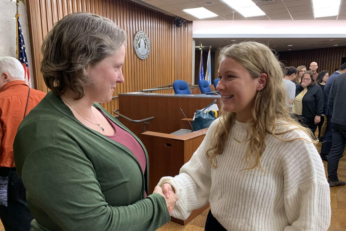 Rohrer shakes hands with mayor