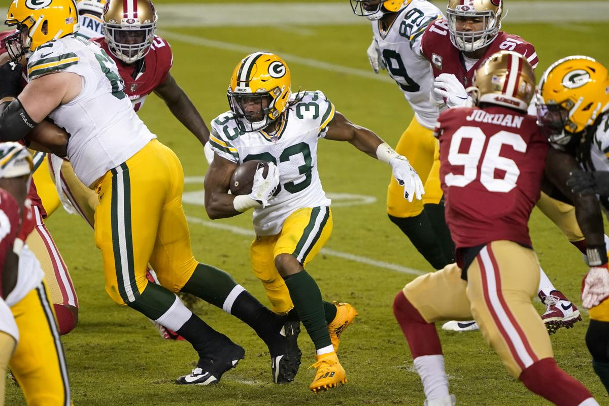Down 2 running backs because of COVID-19, Packers welcome Aaron Jones back  with a bang | Pro football | madison.com