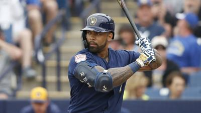 Eric Thames bats, AP photo