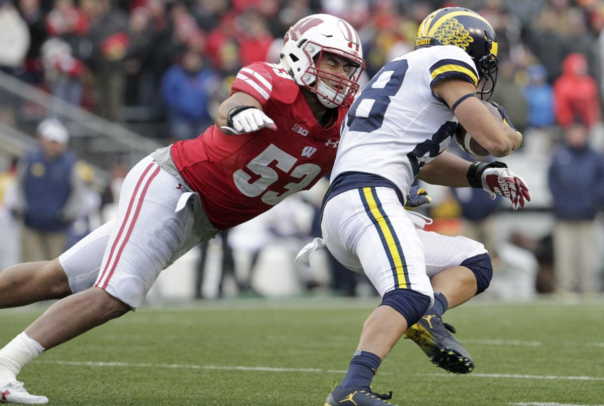 T.J. Edwards tackles, State Journal photo