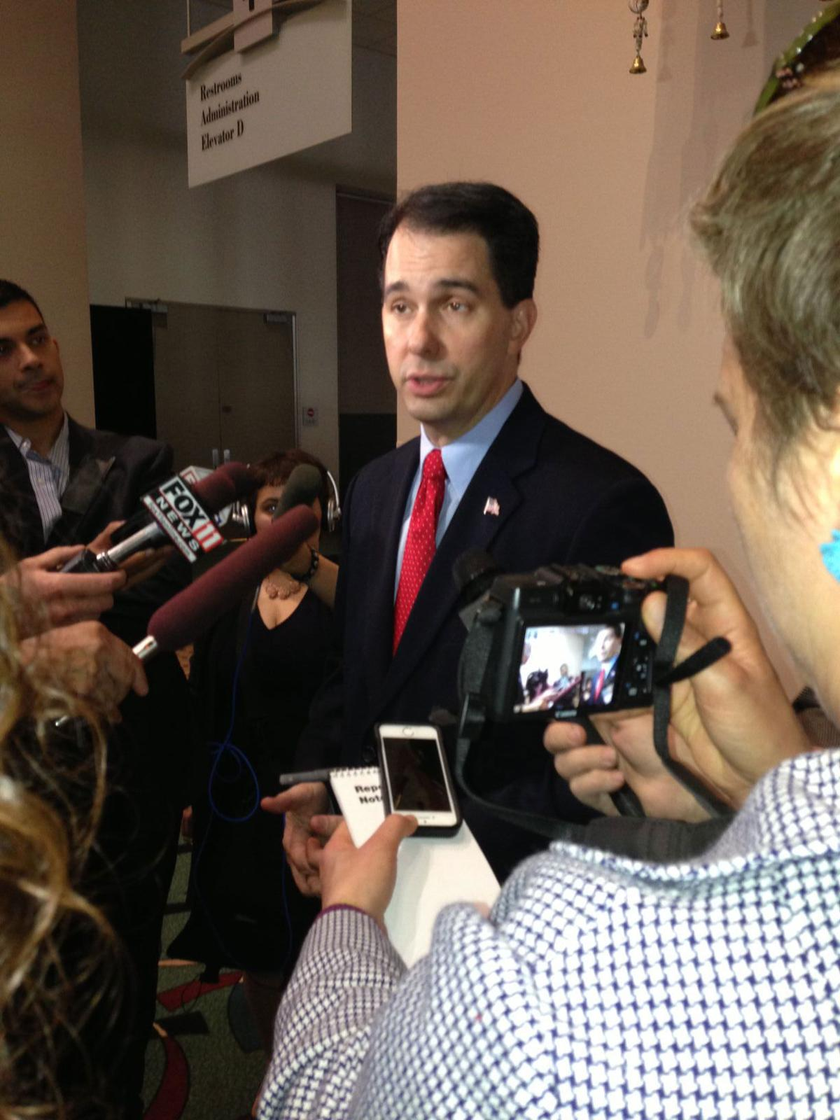 Walker speaks to reporters 2