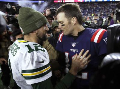 Aaron Rodgers, Tom Brady after game, AP photo