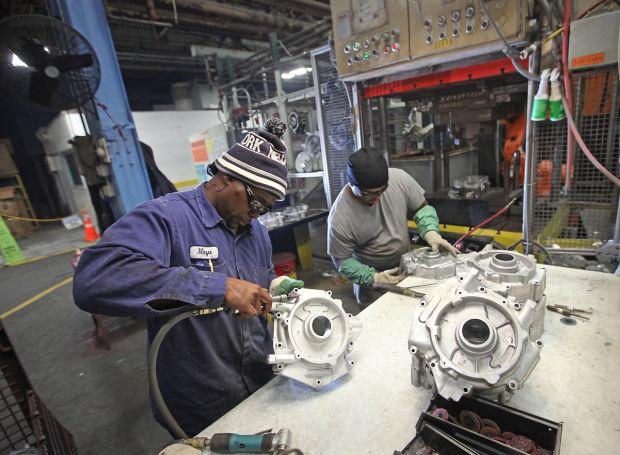Two Madison-Kipp employees working