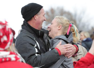 Alicia Monson hugs dad, State Journal photo