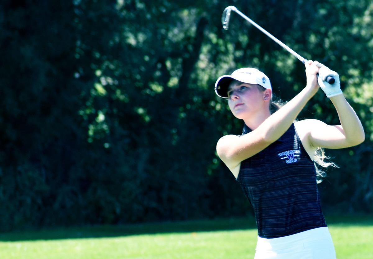 Prep girls golf photo: Waunakee's Aly Kinzel goes for the green