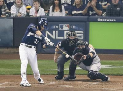 Christian Yelich homers NLDS Game 1, AP photo