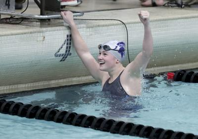 Alexandra Moderski of McFarland realizes her time is a record in the 100 freestyle