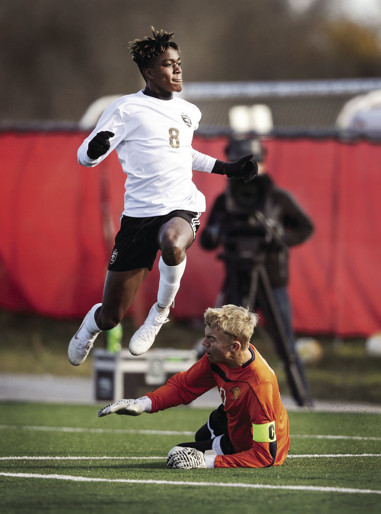 WIAA state boys soccer photo: Oregon's Madison Conduah jumps for joy after a score
