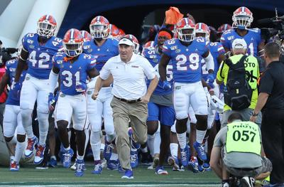 Florida Gators head coach Dan Mullen leads his players onto the field for a game against the University of Miami on Saturday, Aug. 24, 2019 at Camping World Stadium in Orlando, Fla.