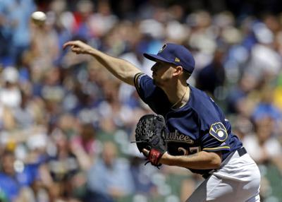 Zach Davies pitching, AP photo