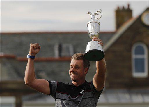 Henrik Stenson with British Open trophy, AP photo