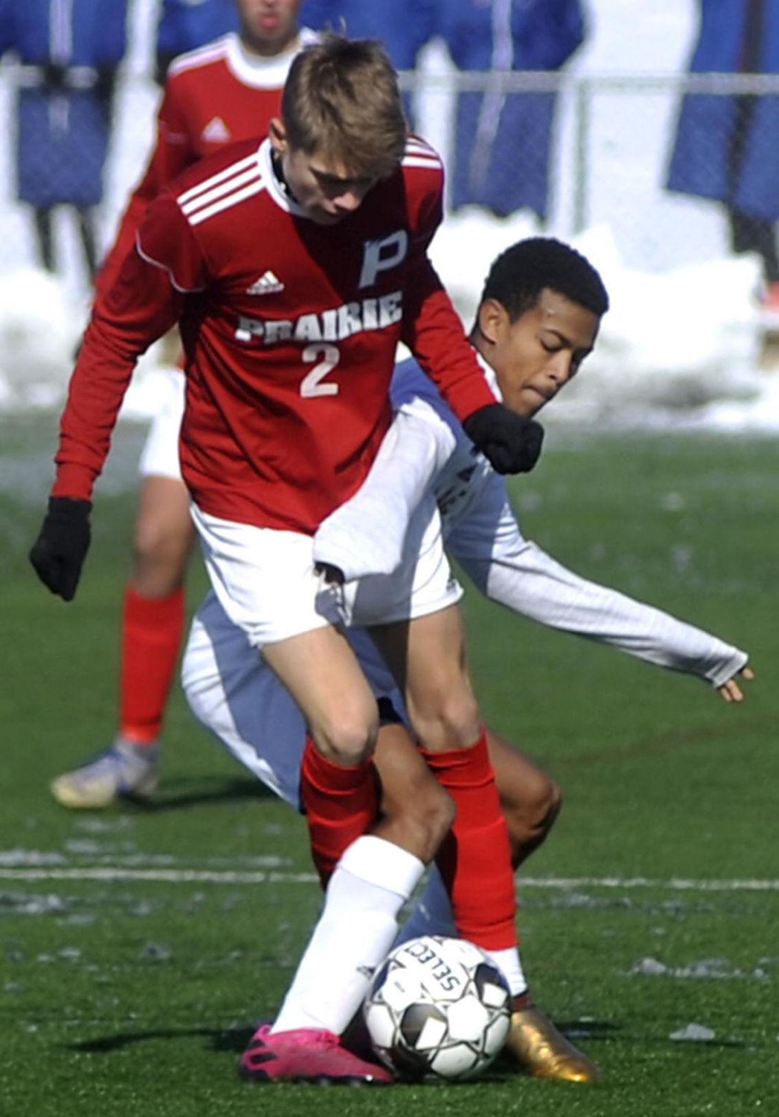 WIAA boys soccer photo: Lake Mills' John Wilke takes on Racine Prairie's Jason Frosch