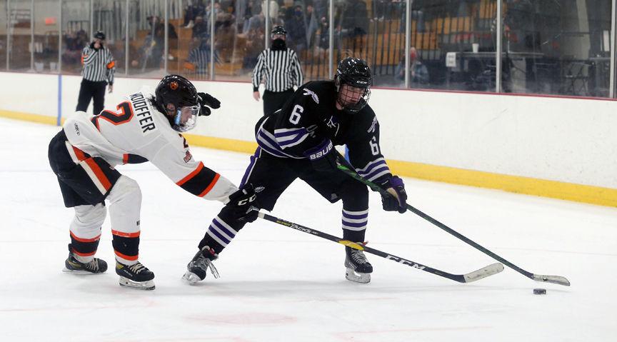 WIAA boys hockey photo: Waunakee's Mac Reed plays keep-away with Verona's Calvin Moioffer