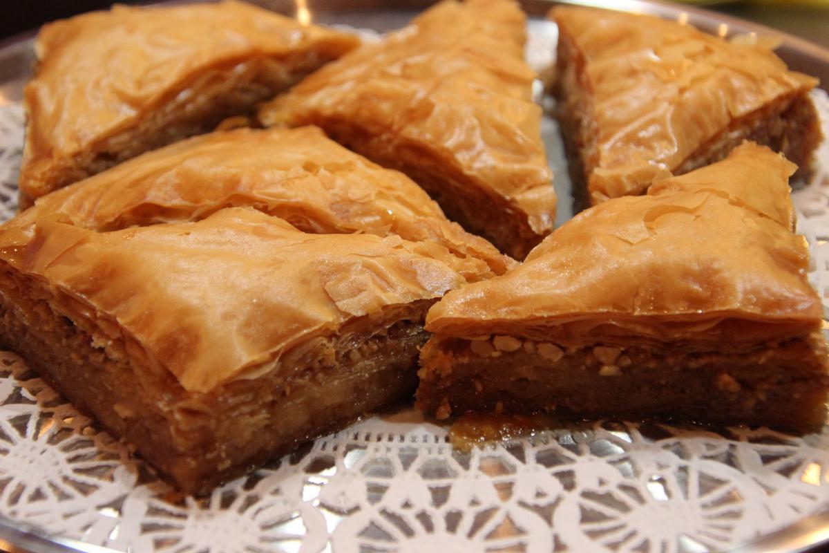 Triangle-cut pieces of Caspian Grill's pistachio baklava dessert.JPG