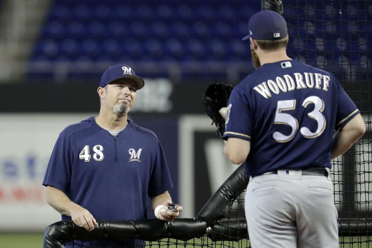 Brewers pitching coach Chris Hook, Brandon Woodruff, 2019 AP photo