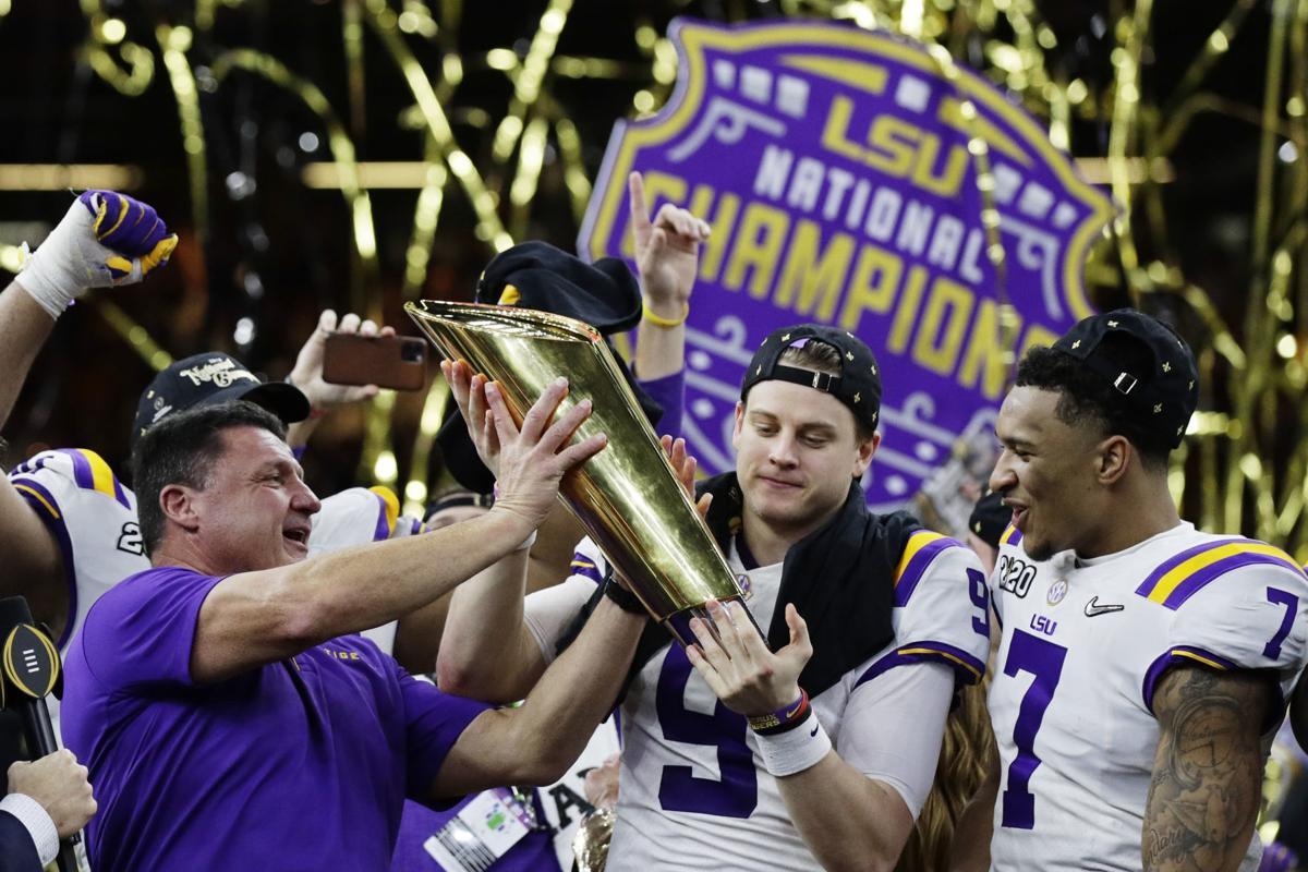 LSU holds trophy, Ed Orgeron, Joe Burrow, Grant Delpit, AP photo