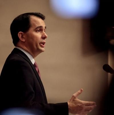 Scott Walker delivers state budget dress, State Journal photo