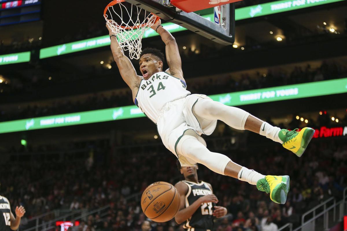 Giannis Antetokounmpo soaring dunk, AP photo