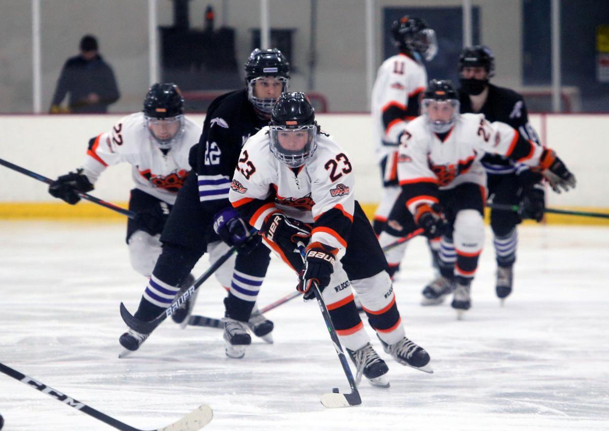 WIAA boys hockey photo: Verona's Jack Marske advances the puck