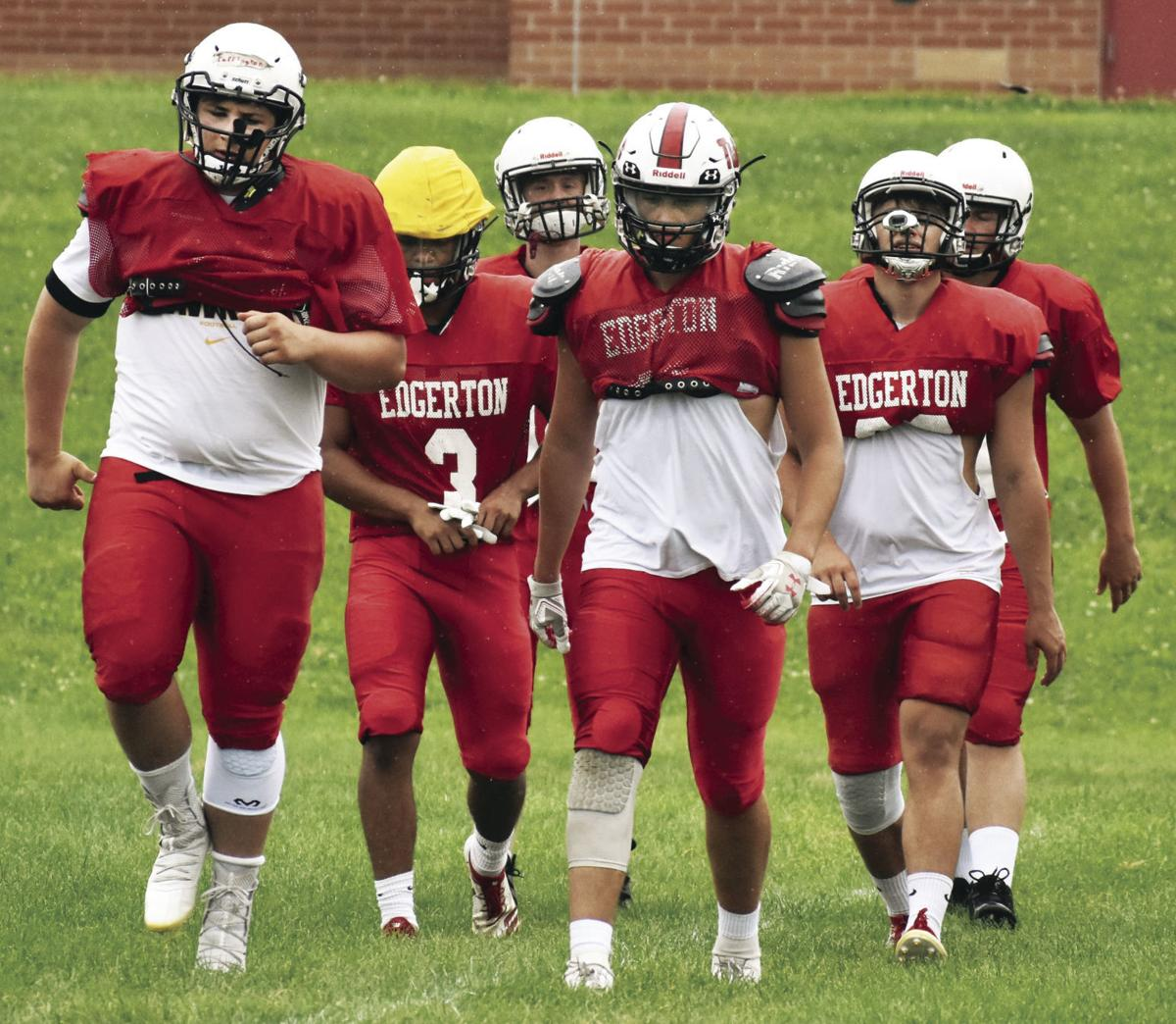 Prep football photo: Edgerton senior linemen Reed Farrington, Ben Wileman lead the Crimson Tide into calisthenics