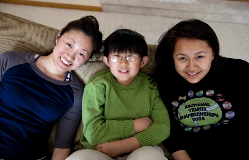 Christopher Xu with sisters