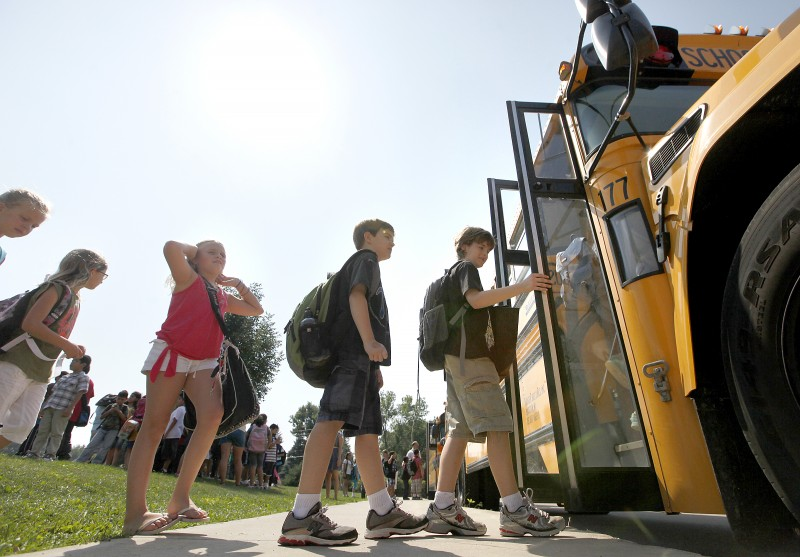 Kids boarding buses on first day of school 2011 (with WSJ editorial)