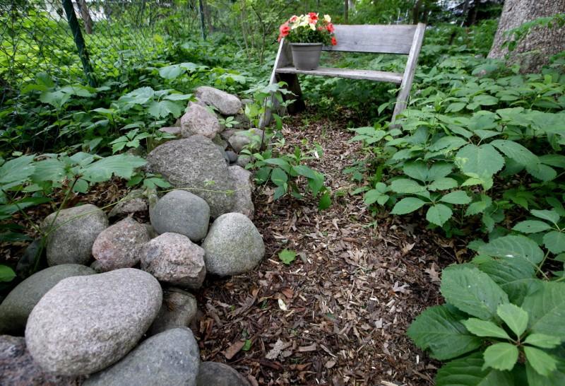 Rock wall, recycled wood keep backyard natural | Lifestyles: Food ...