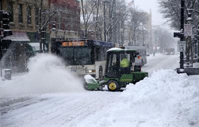 Plowing of city's streets could take all day and night, snow