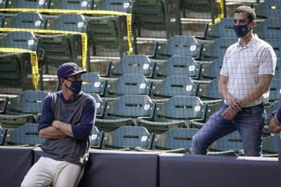 Craig Counsell talks to David Stearns, AP generic file photo