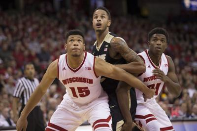 Wisconsin Badgers' Khalil Iverson and Charles Thomas IV ...