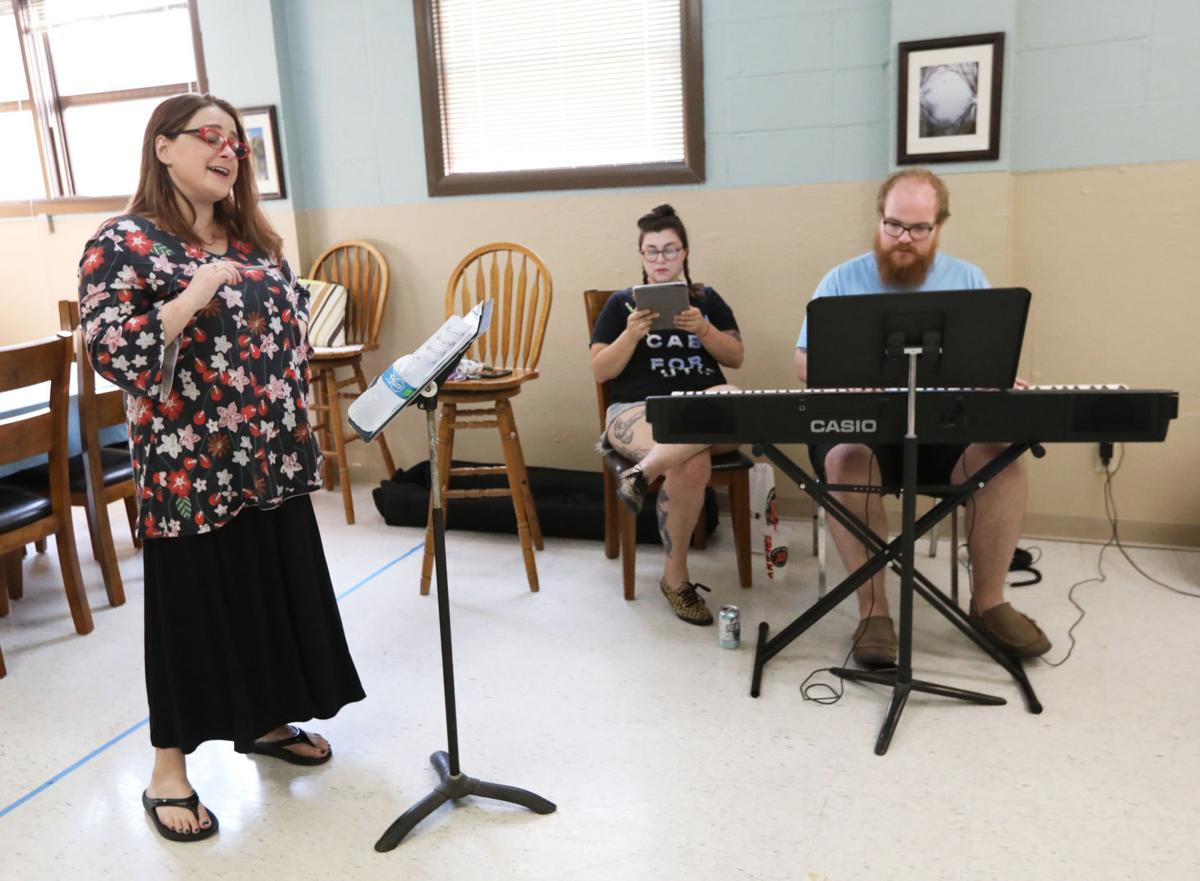 Meghan Randolph in rehearsal with composers Erin McConnell and Evan Lange