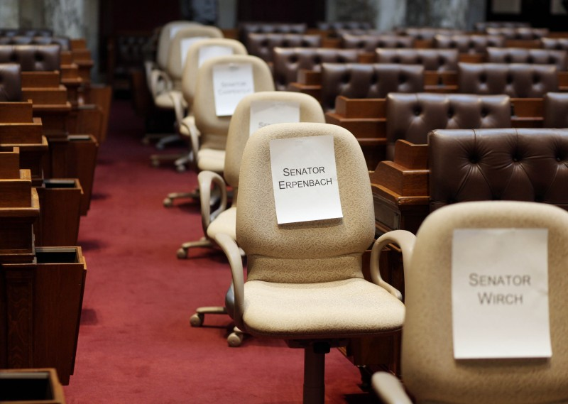 Empty chairs of Senate democrats who fled state